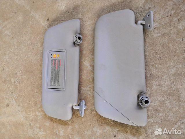 89226688886 Козырек солнцезащитный (Nissan Primera)